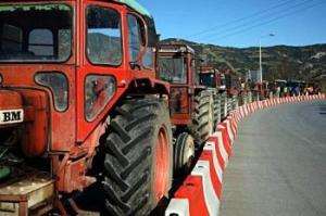 Tractors block the national Athens-Thessaloniki highway in Nikea,