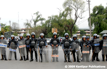 Riot police shielding the Army headquarters, while Maoist supporters stage a rally against Nepal Army Chief Rookmangud Katawal in Kathmandu on Wednesday. (Photo : Narendra Shrestha)